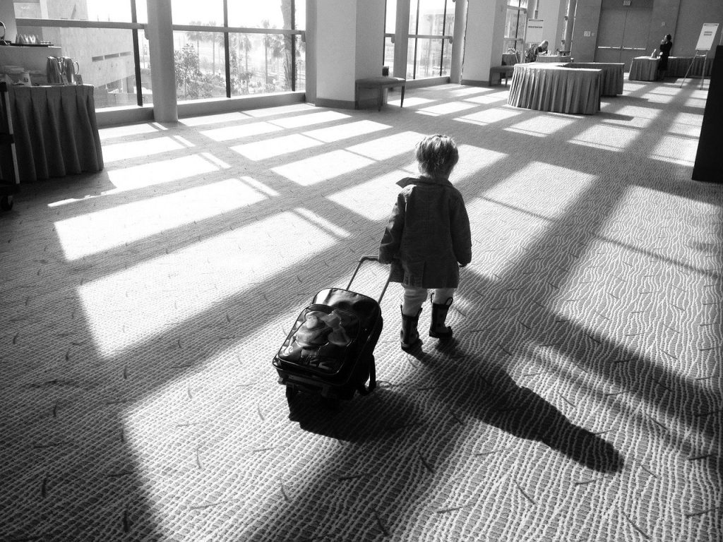 child with subconscious baggage
